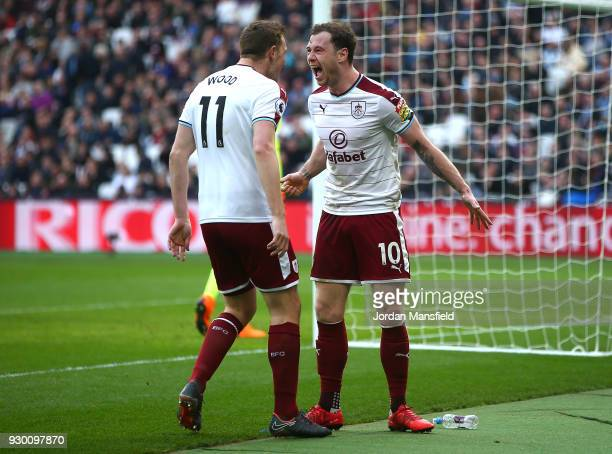 Ashley Barnes of Burnley celebrates with teammate Chris Wood after scoring his sides first goal during the Premier League match between West Ham...