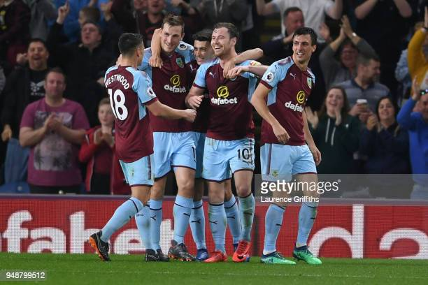Ashley Barnes of Burnley celebrates with teammates after scoring his sides first goal during the Premier League match between Burnley and Chelsea at...