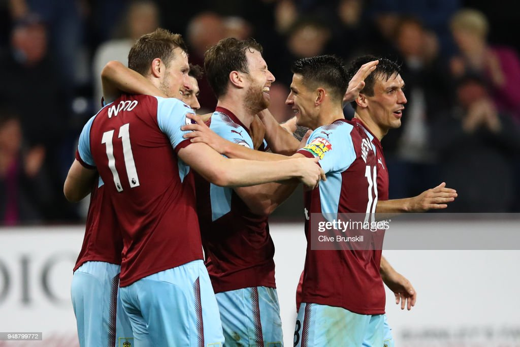Ashley Barnes of Burnley celebrates with teammates after scoring his sides first goal during the Premier League match between Burnley and Chelsea at Turf Moor on April 19, 2018 in Burnley, England.