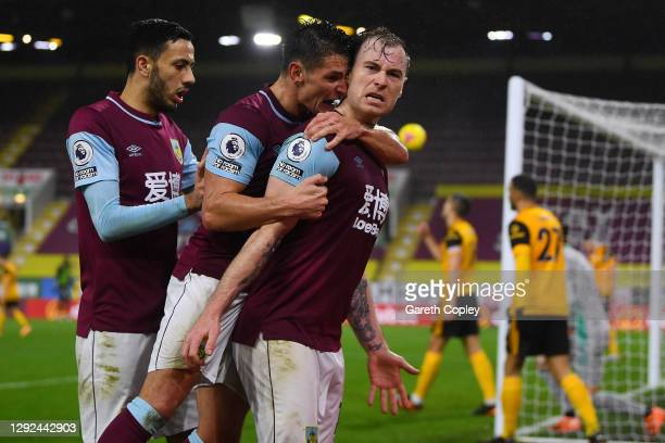 Ashley Barnes of Burnley celebrates with teammates Ashley Westwood and Dwight McNeil after scoring their team's first goal during the Premier League...