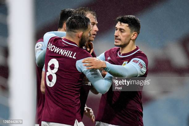 Ashley Barnes of Burnley celebrates with teammates Josh Brownhill and Matthew Lowton after scoring their team's first goal during the Premier League...