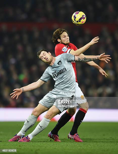 Ashley Barnes of Burnley challenges Daley Blind of Manchester United during the Barclays Premier League match between Manchester United and Burnley...