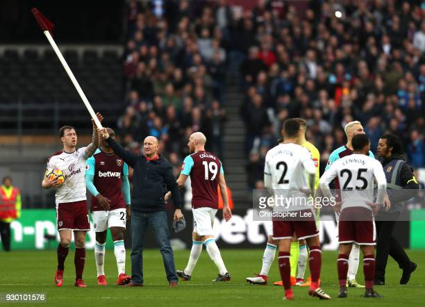 Ashley Barnes of Burnley confronts a pitch Invader who stole the corner flag during the Premier League match between West Ham United and Burnley at...