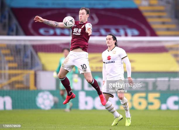 Ashley Barnes of Burnley controls the ball ahead of Ben Gladwin of MK Dons during the FA Cup Third Round match between Burnley and Milton Keynes Dons...