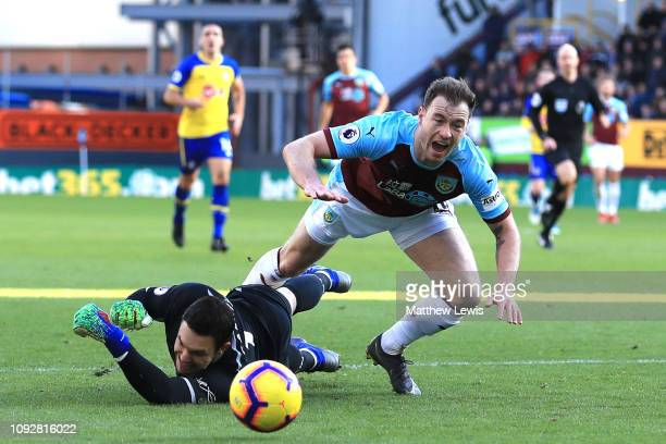 Ashley Barnes of Burnley goes down after a challenge by Alex McCarthy of Southampton during the Premier League match between Burnley FC and...