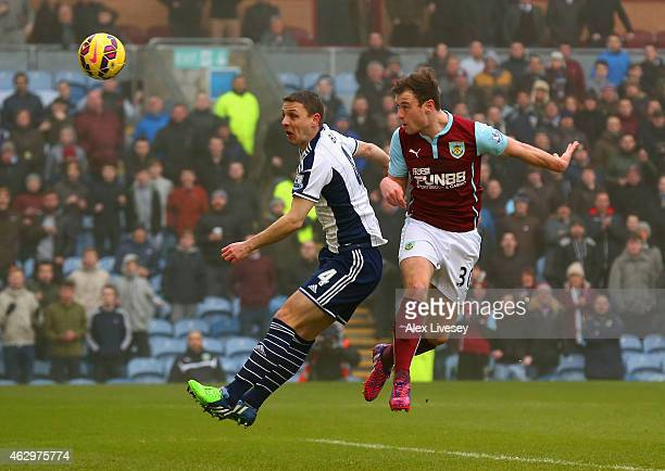 Ashley Barnes of Burnley heads in the opening goal during the Barclays Premier League match between Burnley and West Bromwich Albion at Turf Moor on...