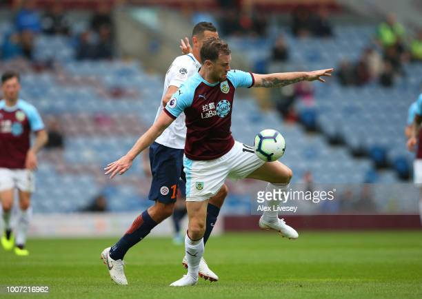 Ashley Barnes of Burnley holds off a challenge from Ellyes Skhiri of Montpellier during a preseason friendly match between Burnley and Montpellier at...