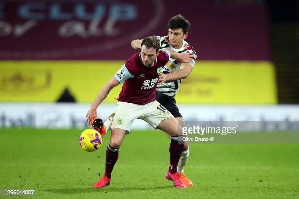 Ashley Barnes of Burnley holds off Harry Maguire of Manchester United during the Premier League match between Burnley and Manchester United at Turf...