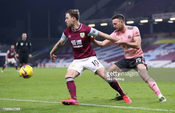 Ashley Barnes of Burnley holds off Jack Robinson of Sheffield United during the Premier League match between Burnley and Sheffield United at Turf...
