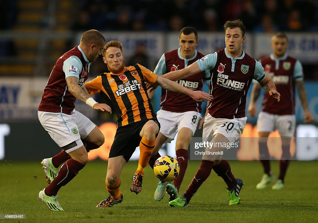 Ashley Barnes (R) of Burnley in action with Stephen Quinn of Hull City during the Barclays Premier League match between Burnley and Hull City at Turf Moor on November 08, 2014 in Burnley, England.