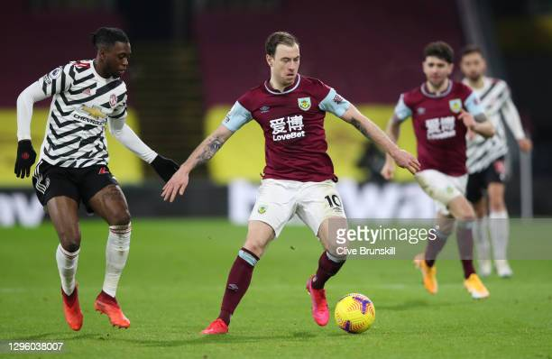 Ashley Barnes of Burnley is challenged by Aaron Wan-Bissaka of Manchester United during the Premier League match between Burnley and Manchester...
