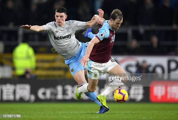 Ashley Barnes of Burnley is challenged by Declan Rice of West Ham United during the Premier League match between Burnley FC and West Ham United at...