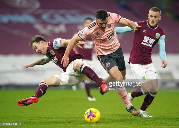 Ashley Barnes of Burnley is challenged by Enda Stevens of Sheffield United during the Premier League match between Burnley and Sheffield United at...