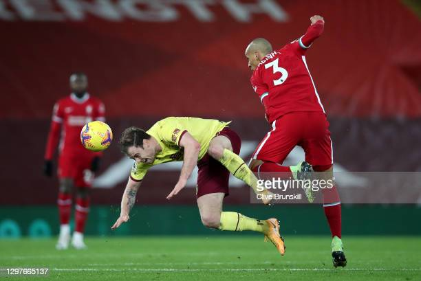 Ashley Barnes of Burnley is challenged by Fabinho of Liverpool during the Premier League match between Liverpool and Burnley at Anfield on January...
