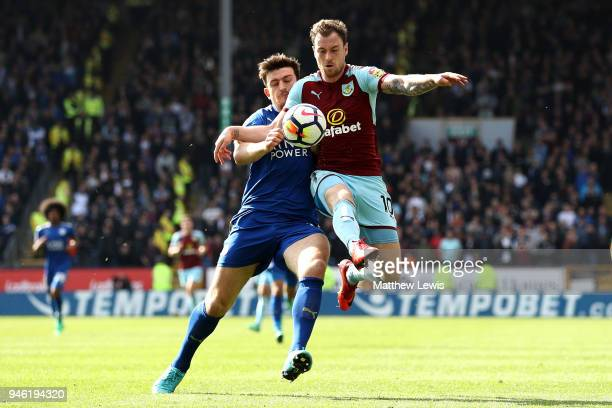 Ashley Barnes of Burnley is challenged by Harry Maguire of Leicester City during the Premier League match between Burnley and Leicester City at Turf...