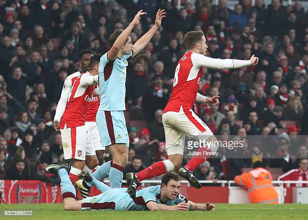 Ashley Barnes of Burnley is challenged in the area resulting in a penalty kick to Burnley during the Premier League match between Arsenal and Burnley...