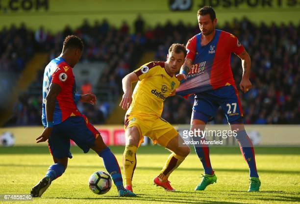 Ashley Barnes of Burnley is closed down by Patrick van Aanholt and Damien Delaney of Crystal Palace during the Premier League match between Crystal...