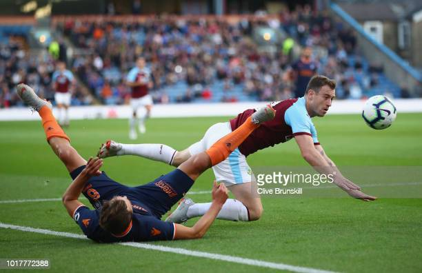 Ashley Barnes of Burnley is tackled by Alexandru Epureanu of Istanbul Basaksehir during the UEFA Europa League third round qualifier second leg...