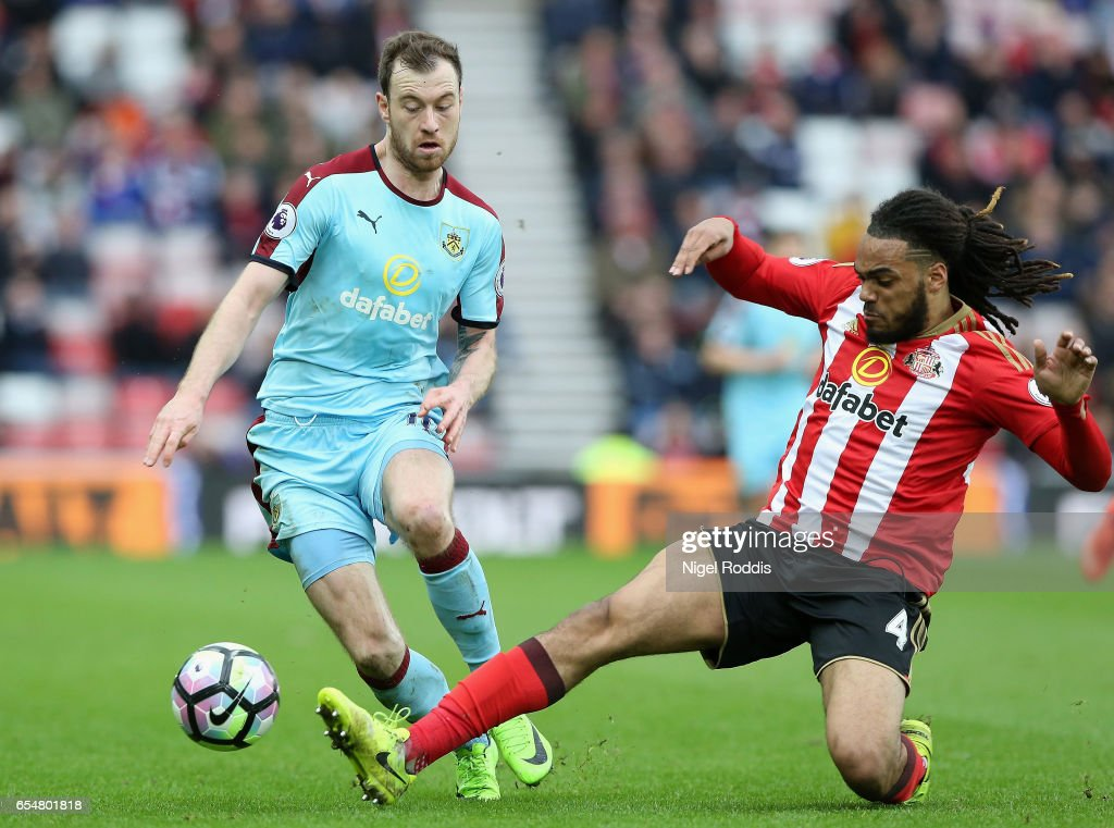 Ashley Barnes of Burnley (L) is tackled by Jason Denayer of Sunderland (R) during the Premier League match between Sunderland and Burnley at Stadium of Light on March 18, 2017 in Sunderland, England.