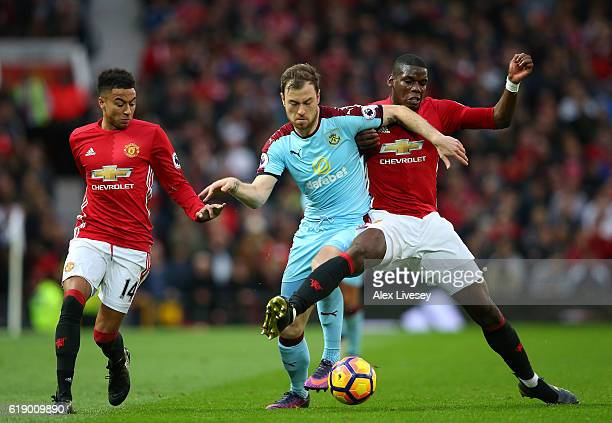 Ashley Barnes of Burnley is tackled by Paul Pogba of Manchester United and is put under pressure from Jesse Lingard of Manchester United during the...