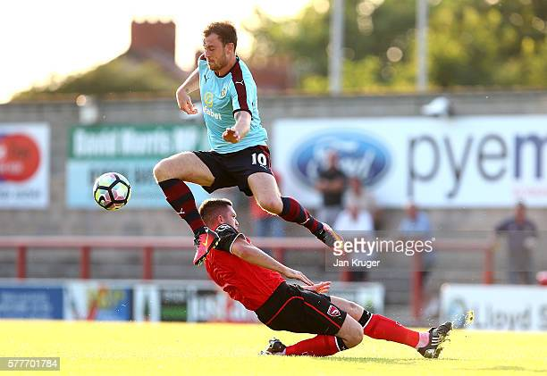 Ashley Barnes of Burnley leaps over a tackle during the pre season friendly match between Morecambe and Burnley at Globe Arena on July 19 2016 in...