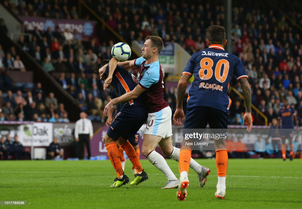 Ashley Barnes of Burnley looks for a handball against Mahmut Tekdemir of Istanbul Basaksehir during the UEFA Europa League third round qualifier second leg between Burnley and Istanbul Basaksehir at Turf Moor on August 16, 2018 in Burnley, England.