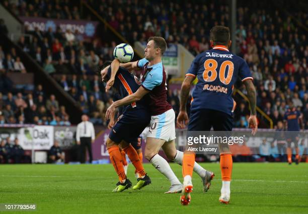 Ashley Barnes of Burnley looks for a handball against Mahmut Tekdemir of Istanbul Basaksehir during the UEFA Europa League third round qualifier...