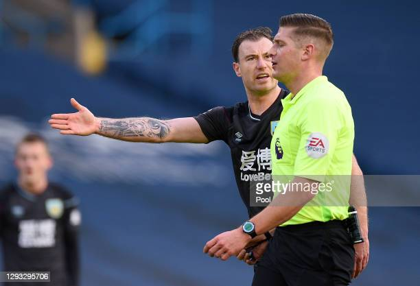 Ashley Barnes of Burnley protests with referee Robert Jones during the Premier League match between Leeds United and Burnley at Elland Road on...
