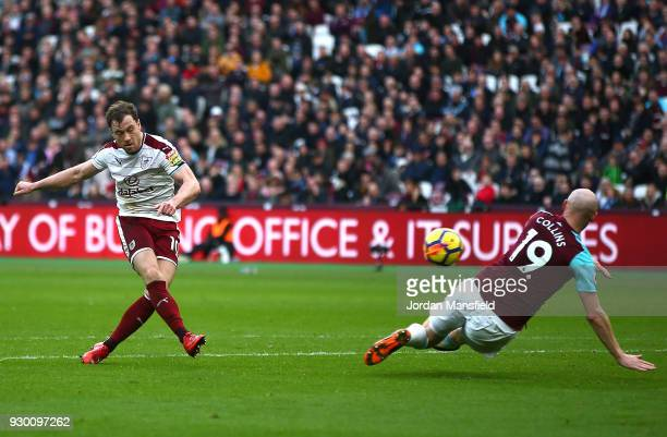 Ashley Barnes of Burnley scores his side's first goal during the Premier League match between West Ham United and Burnley at London Stadium on March...