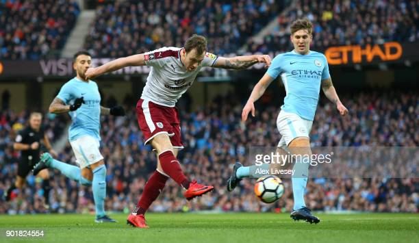 Ashley Barnes of Burnley scores the first goal during the The Emirates FA Cup Third Round match between Manchester City and Burnley at Etihad Stadium...