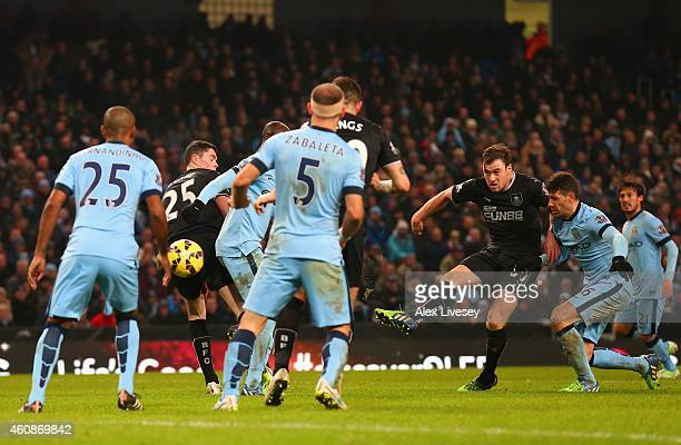 Ashley Barnes of Burnley scores their second goal during the Barclays Premier League match between Manchester City and Burnley at Etihad Stadium on...