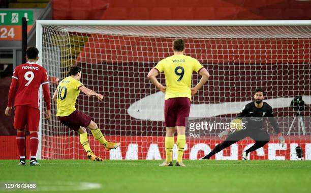 Ashley Barnes of Burnley scores their side's first goal from the penalty spot past Alisson Becker of Liverpool during the Premier League match...