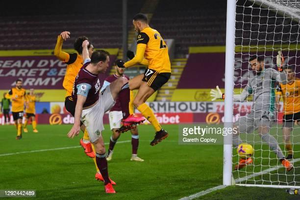 Ashley Barnes of Burnley scores their team's first goal past Romain Saiss of Wolverhampton Wanderers and Rui Patricio of Wolverhampton Wanderers...