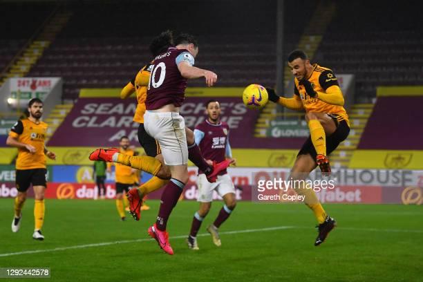 Ashley Barnes of Burnley scores their team's first goal past Romain Saiss of Wolverhampton Wanderers during the Premier League match between Burnley...