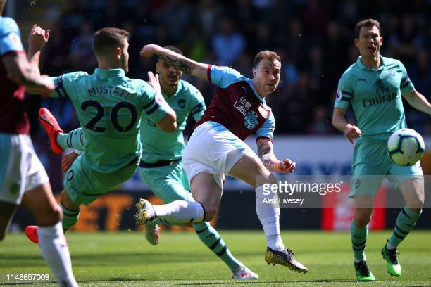 Ashley Barnes of Burnley shoots during the Premier League match between Burnley FC and Arsenal FC at Turf Moor on May 12 2019 in Burnley United...