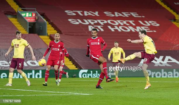 Ashley Barnes of Burnley shoots whilst being closed down by Joel Matip of Liverpool during the Premier League match between Liverpool and Burnley at...