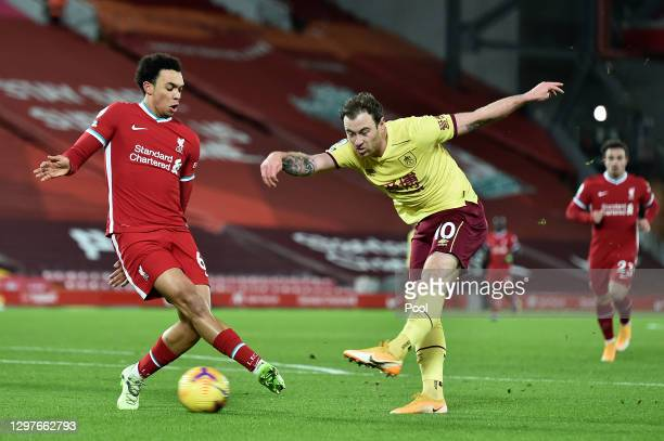 Ashley Barnes of Burnley shoots whilst under pressure from Trent Alexander-Arnold of Liverpool during the Premier League match between Liverpool and...