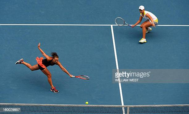 Ashley Barty of Australia looks on as compatriot Casey Dellacqua plays a return during their women's doubles final against Sara Errani and Roberta...