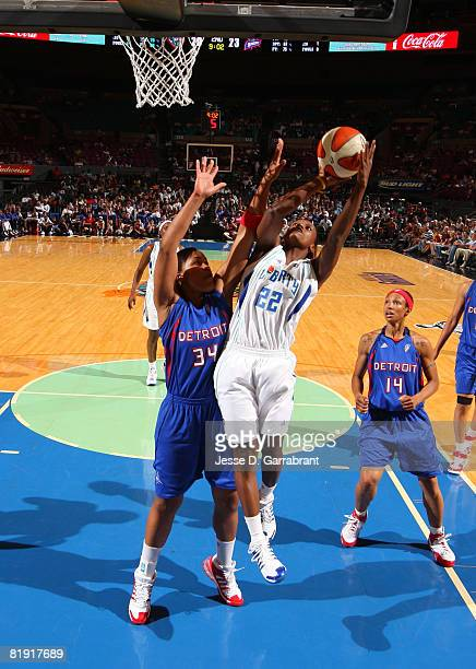 Ashley Battle of the New York Liberty shoots against Tasha Humphry of the Detroit Shock during the game on July 12 2008 at Madison Square Garden in...
