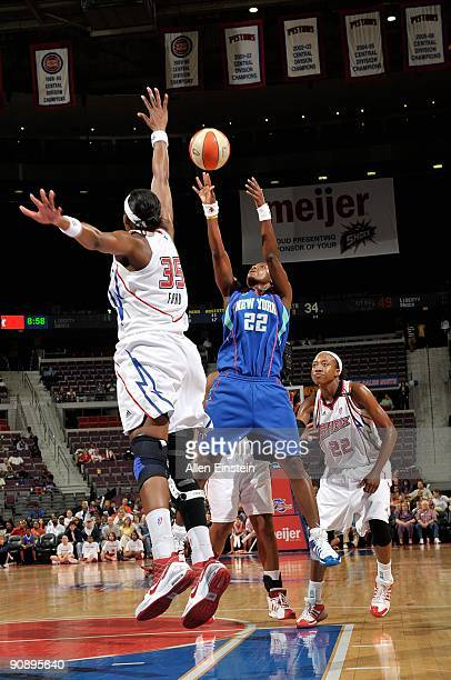 Ashley Battle of the New York Liberty shoots over Cheryl Ford of the Detroit Shock during the WNBA game on September 10 2009 at The Palace of Auburn...