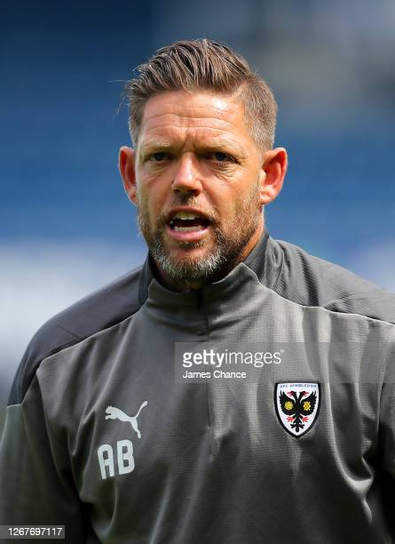 Ashley Bayes Goalkeeper coach at AFC Wimbledon looks on prior to the PreSeason Friendly between Queens Park Rangers and AFC Wimbledon at The Kiyan...