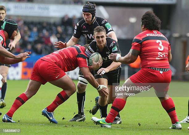 Ashley Beck of Ospreys charges upfield during the Heineken Cup match between Ospreys and Stade Toulouse at the Liberty Stadium on December 15 2012 in...