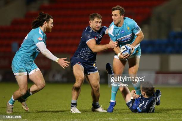Ashley Beck of Worcester hands off to Morris Oli of Worcester as he is tackled by AJ MacGinty of Sale during the Gallagher Premiership Rugby match...