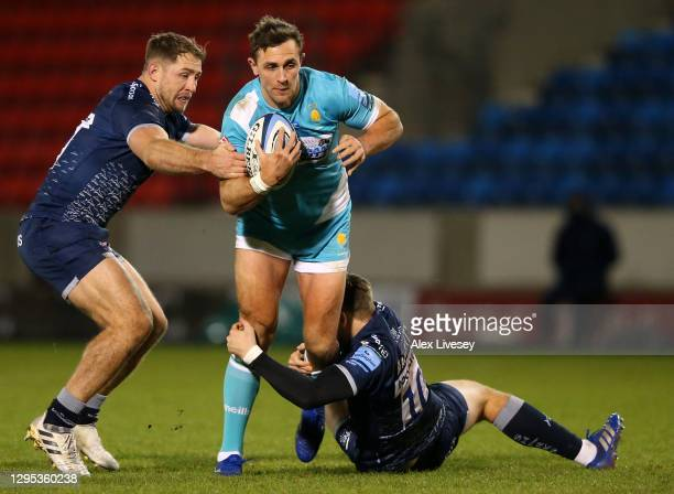 Ashley Beck of Worcester is tackled by AJ MacGinty of Sale during the Gallagher Premiership Rugby match between Sale Sharks and Worcester Warriors at...