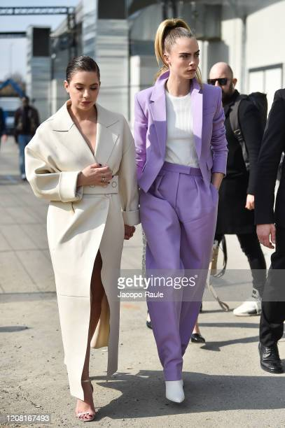 Ashley Benson and Cara Delecingne attend the Boss fashion show on February 23, 2020 in Milan, Italy.