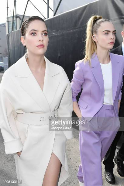 Ashley Benson and Cara Delevingne arrive at the Boss fashion show on February 23, 2020 in Milan, Italy.