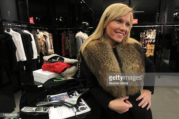 Ashley Bernon of Wellesley waits to check out items while shopping at Saks Fifth Avenue at the Prudential Center