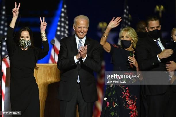 Ashley Biden, daughter of Joe Biden, US President-elect Joe Biden, wife Jill Biden and Hunter Biden salute the crowd after delivering remarks in...