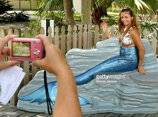 Ashley Bobo of Nashville Tennessee sits in a fake mermaid tail in Weeki Wachee springs Florida July 25 2007