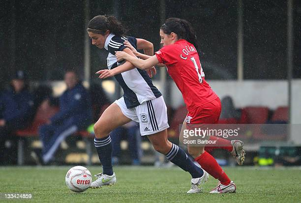 Ashley Brown of the Victory and Donna Cockayne of United compete for the ball during the round five WLeague between the Melbourne Victory and...